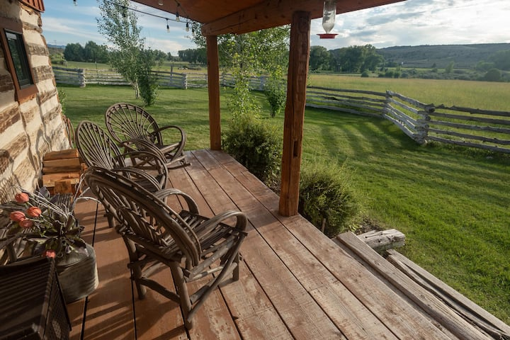 1 BR Log Cabin | Front porch overlooking vast meadow | Pond | Kitchen