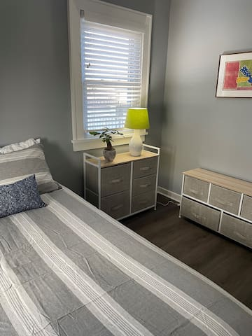 Queen bedroom with closet and dressers
