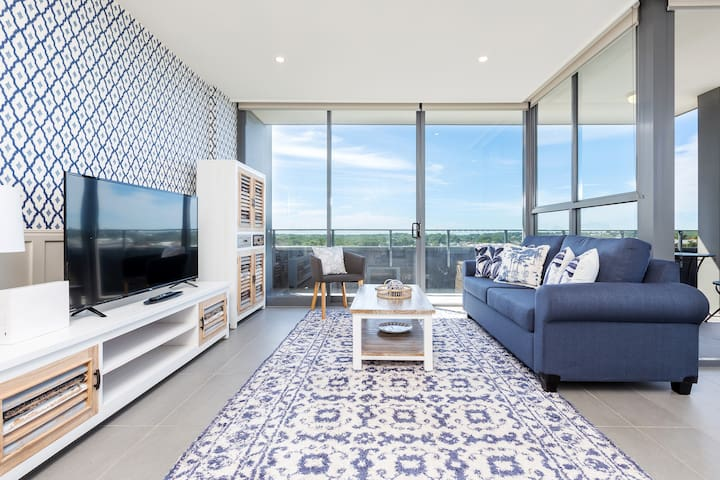 Spacious Living room equipped with smart tv that includes free Netflix and Foxtel. Comfortable 3 seater couch to enjoy your streaming from.