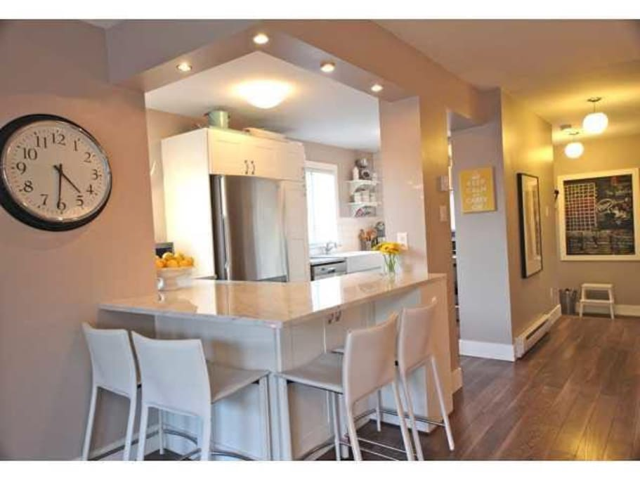 Great breakfast bar that comfortably seats 4 and the dining table just to the right!