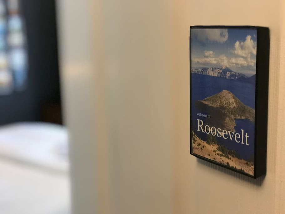 The Roosevelt Room is marked with a sign and photo of Crater Lake National Park in Oregon.