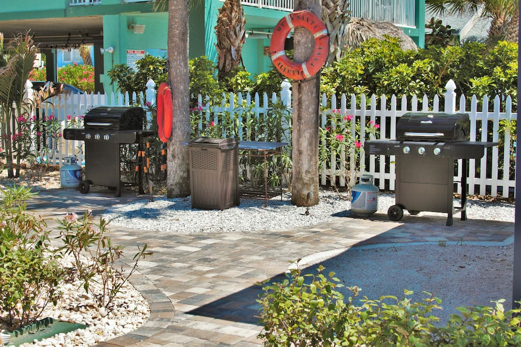 Two shared gas grills with beautiful ocean views to your right.