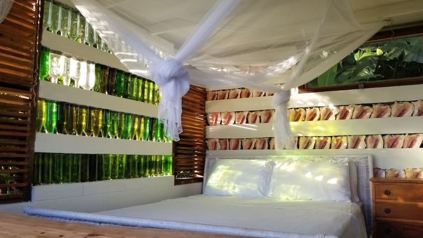 Queen bed with deep mattress with gel filled topper.  Cotton linen.  Two pillows each.  Straight sided mosquito net.  Wall mounted fan.