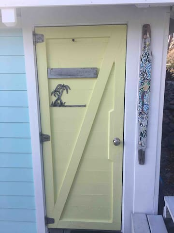 Entrance to Ocean Blue Cottage, just 22 steps down from the road where you park you vehicle.
