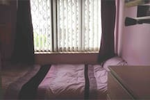 Double bed in small comfortable room