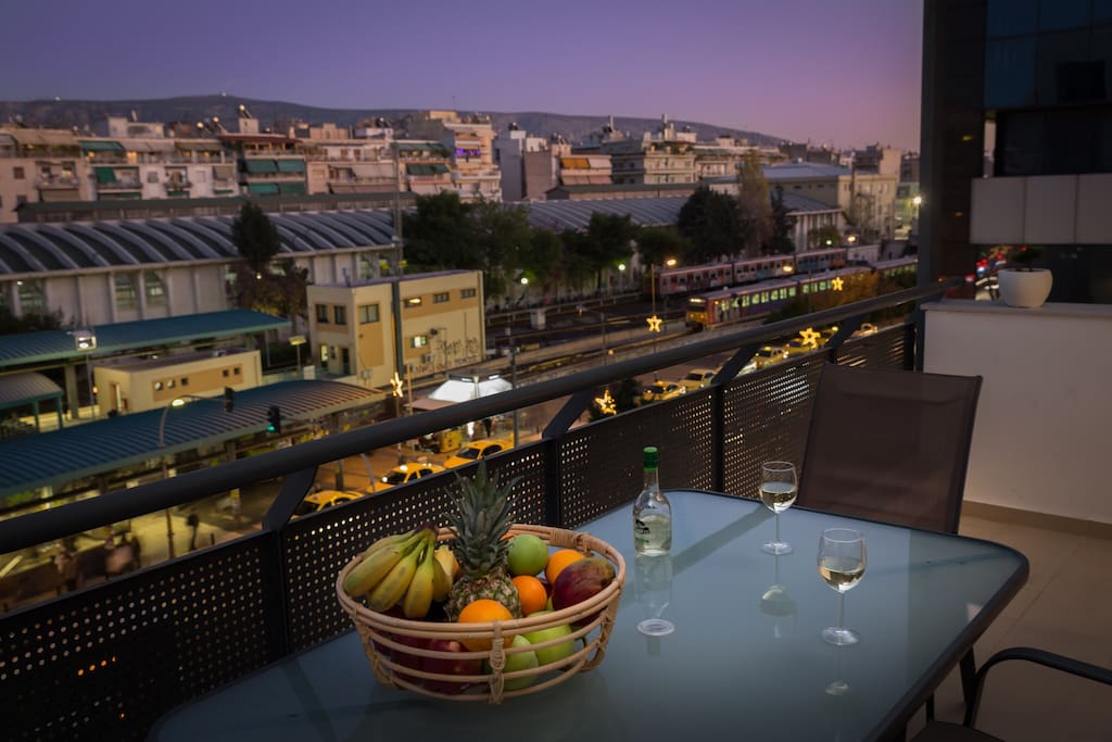 Spacious balcony overlooking evening Athens