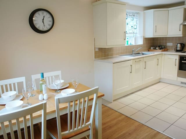 bright dining/kitchen area