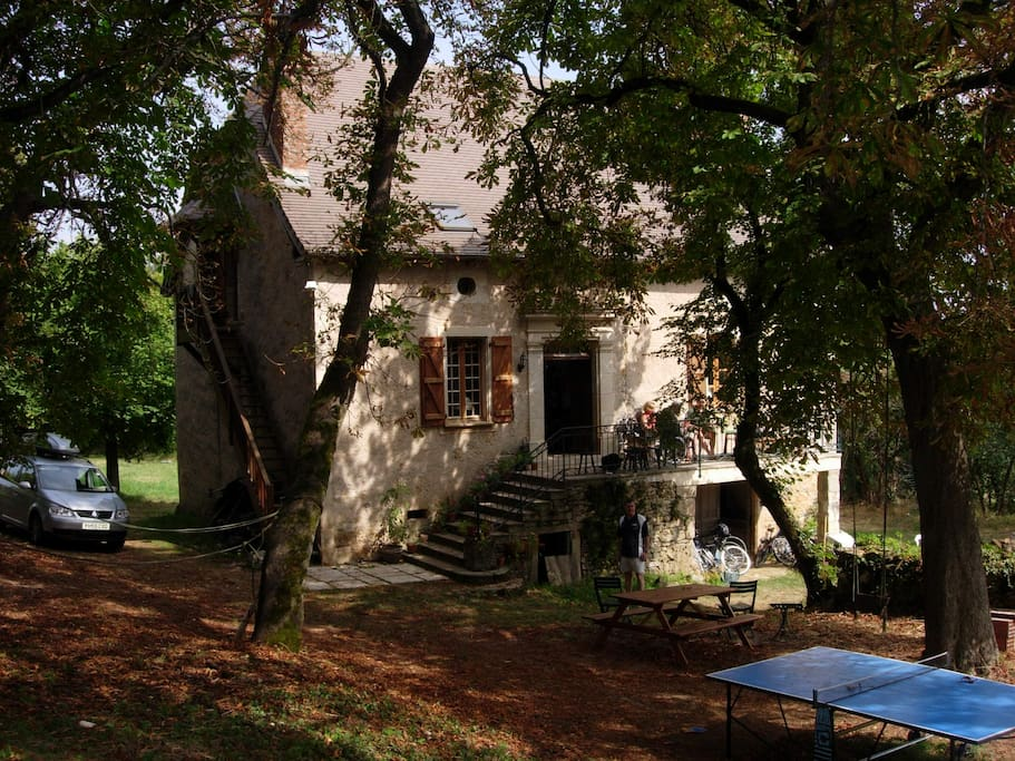 the back of the house facing away from the road and shaded by chestnut trees