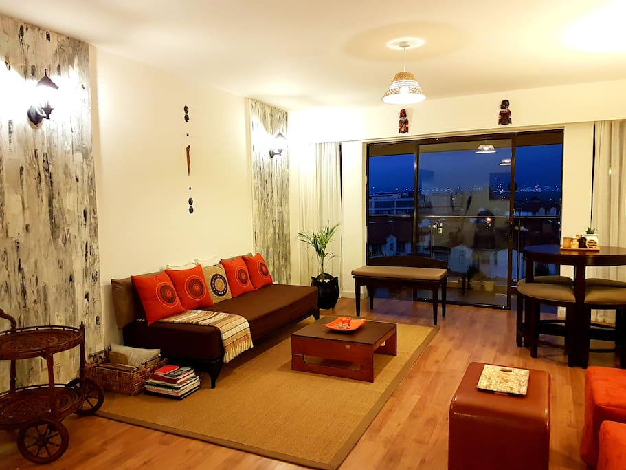 Relax in the elegant, spacious living room while taking in the lovely view outside.