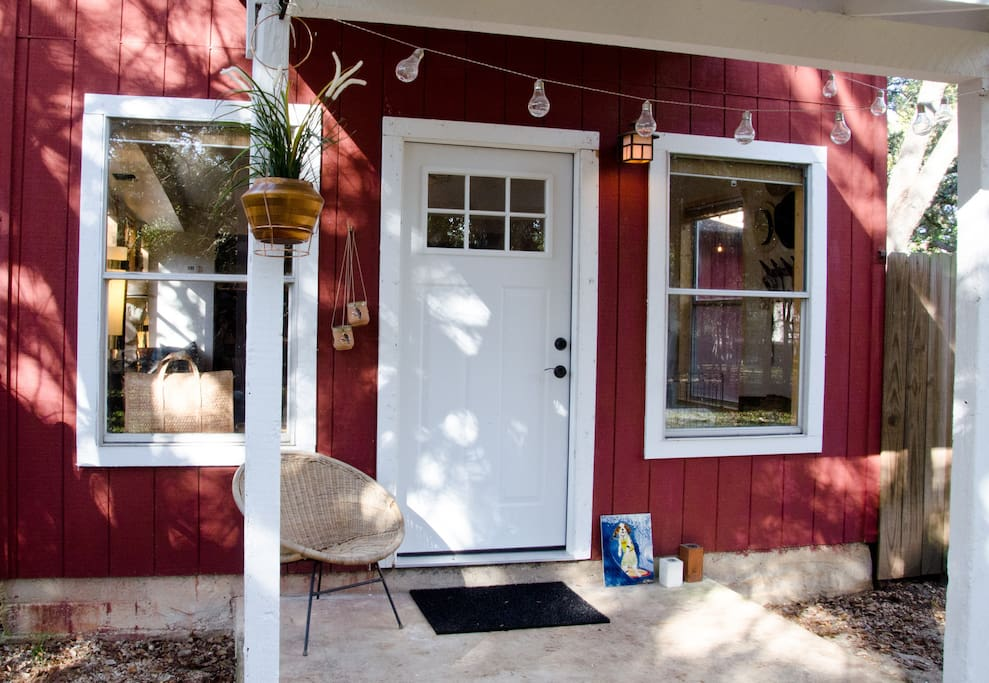 The front porch entrance. Marthe chose red paint and white trim to reference traditional barn colors in her native Norway.