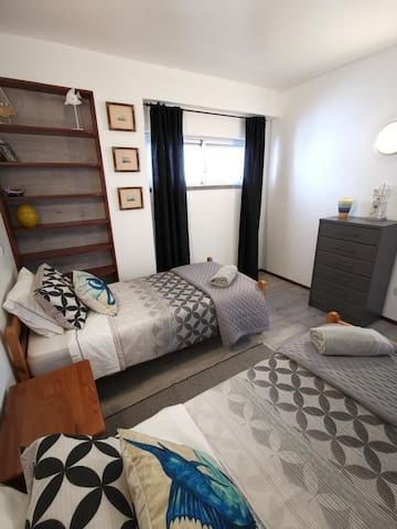 Second bedroom with two twin beds.