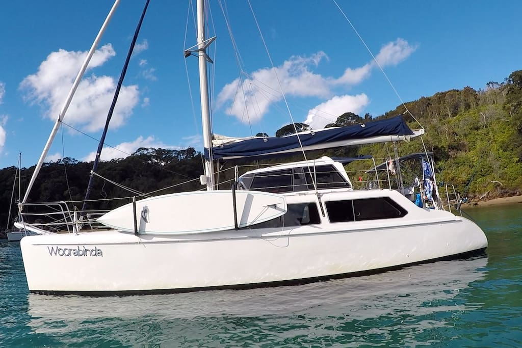 Seawind 1000 commercial catamaran in survey with carbon paddle board