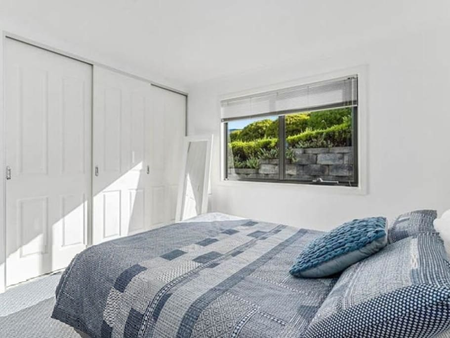 Sunny bed room with queen bed and built in wardrobe