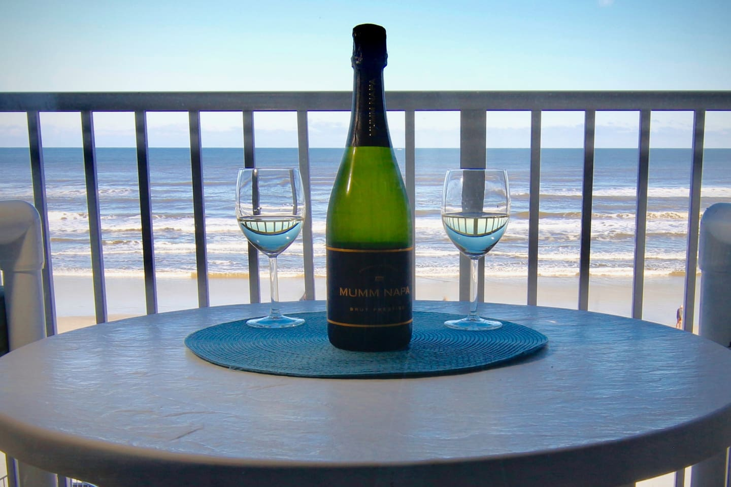 Our direct full frontal view of the Atlantic and sandy beaches from the 3rd-floor balcony.  Now it's time for a little bubbly.