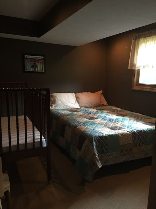 #3 This room has a queen size bed (memory foam mattress) as well as a crib. Small dresser in closet.
