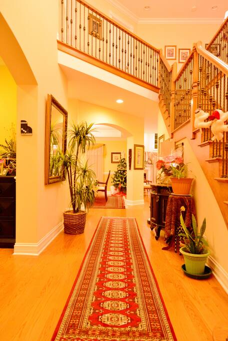 Hall way and stairs that lead to three bedrooms upstairs