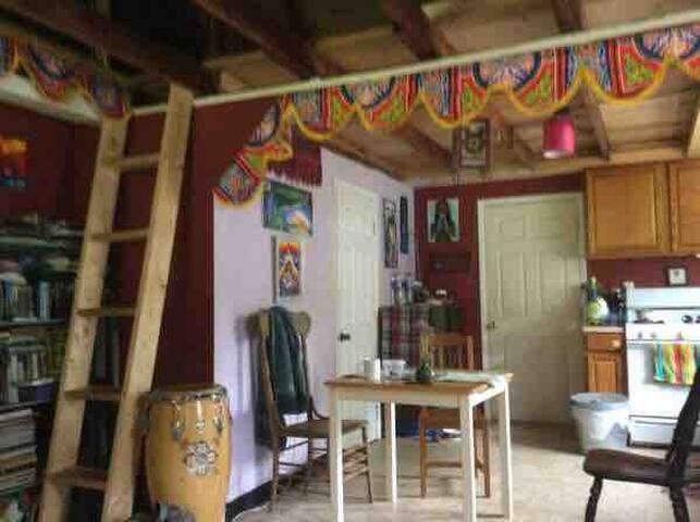 Living room/kitchen area.