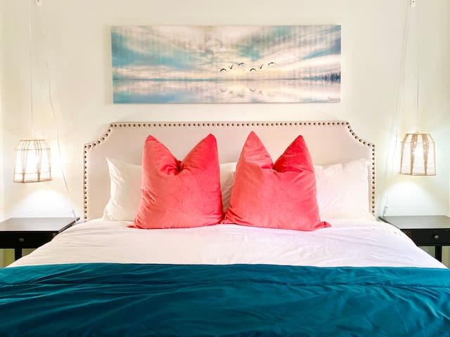 king bed with handmade bedside lamps
