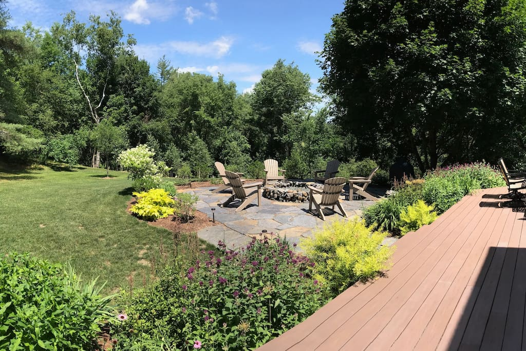 Private backyard with fire pit, Big Green grill, hot tub, deck, and trail to Connecticut River