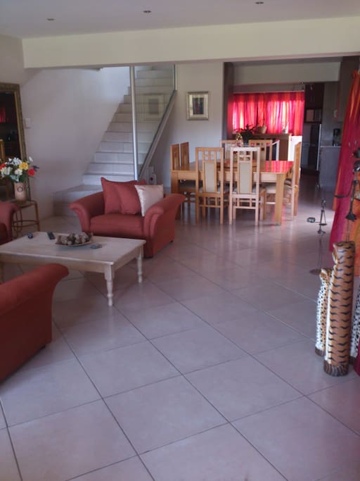 Indoor braai, lounge, dining room and kitchen on the first floor, lovely open plan