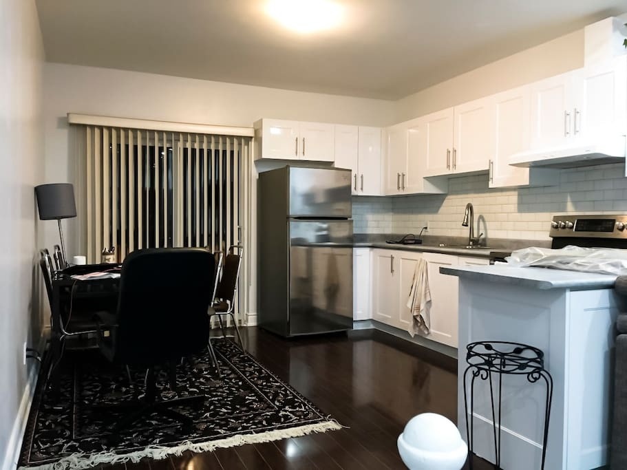 Kitchen / Dining Area with a Balcony, located behind the shades