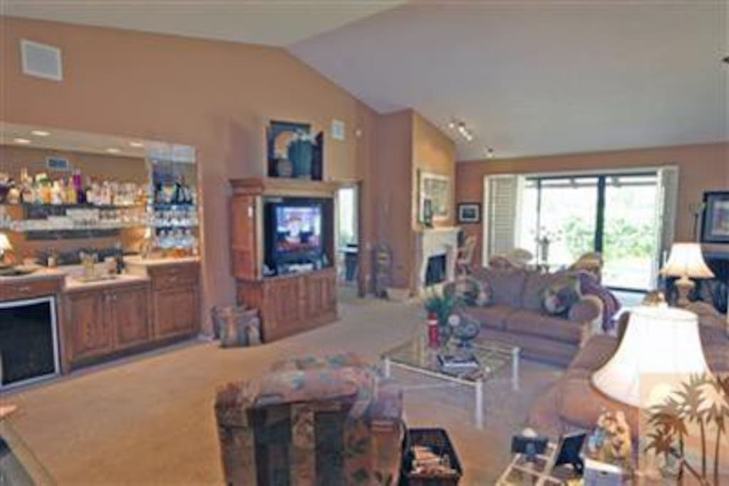 Large living room with flat screen TV.