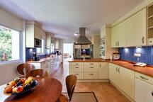 Large bright fully equipped kitchen with breakfast area
