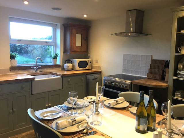 The kitchen is fully equipped for cooking, and has a belfast sink, dishwasher and electric cooker with extractor.