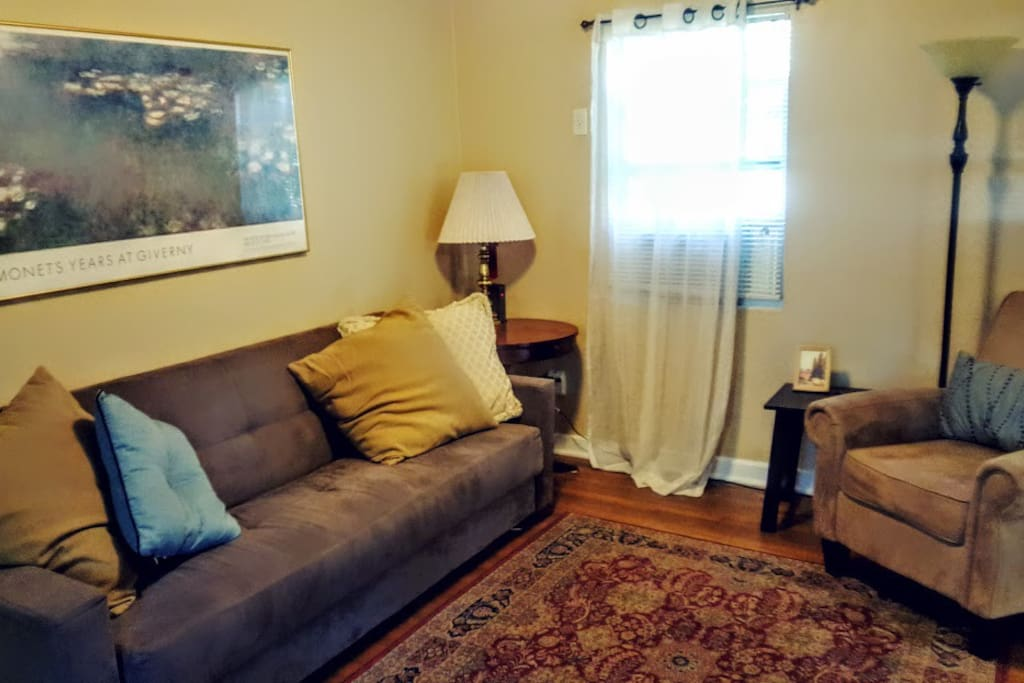 The living room as you first enter the cottage. Futon folds out into a bed. Extra linens provided.