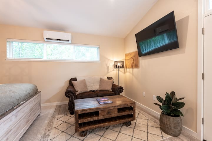 Cuddle up on this super comfy love seat while you take in the pretty views of the nature that surrounds you or watch your favorite streaming apps on the large smart tv.