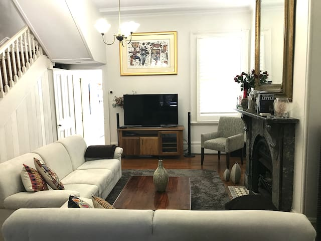 Spacious lounge with comfy couches, cable (Foxtel) TV, and gas-fired fireplace