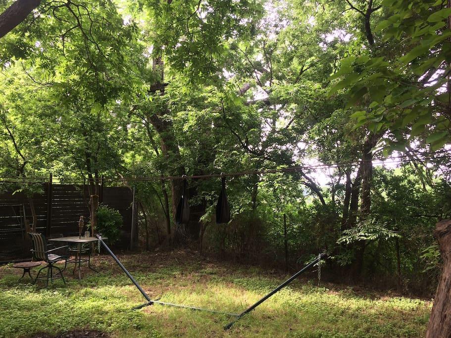 Backyard with hammock set up (hammock not included)