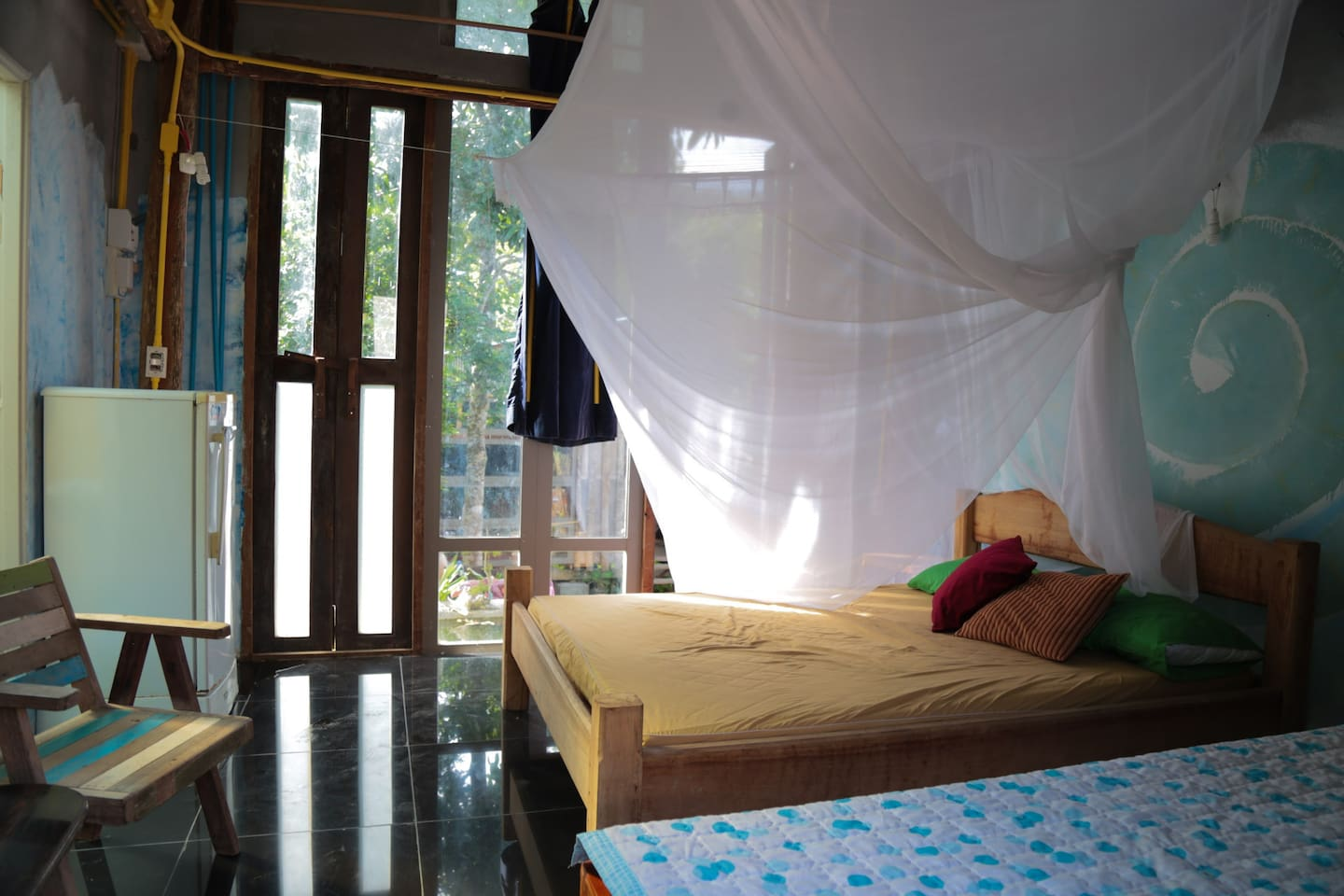One Queen size bed  5 feet wide for 2 persons include mosquito net for   Premium safe from insects.