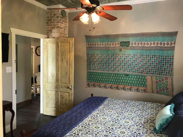 Master bedroom with original brick chimney
