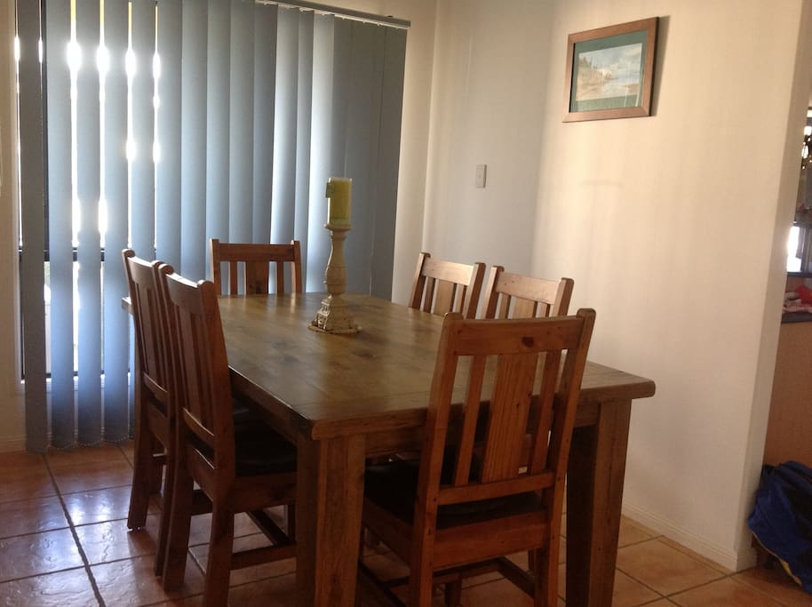 6 person dining suite inside as well as a 6 seater outdoor bbq setting