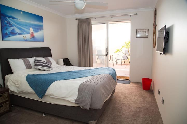 Second main bedroom with private deck with hot and cold shower