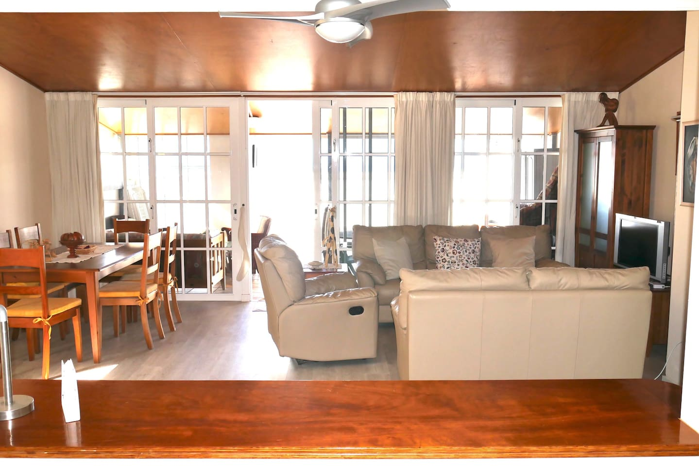 Lounge and dining area with balcony door.