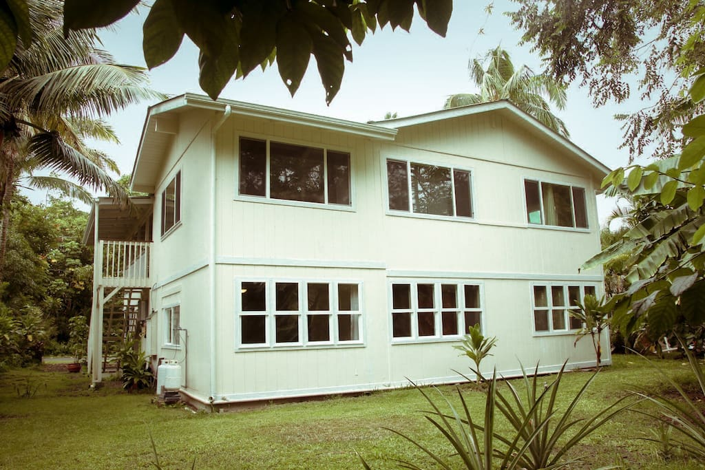 Exterior Back Side View of Large and beautiful home just a short walk to the world famous Wai Opea Pools.  Duplex includes 2 living spaces, 2 full kitchens, 6 bedrooms, 3 bathrooms