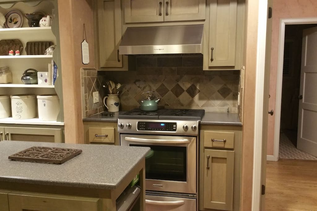 Kitchen with gas stove.