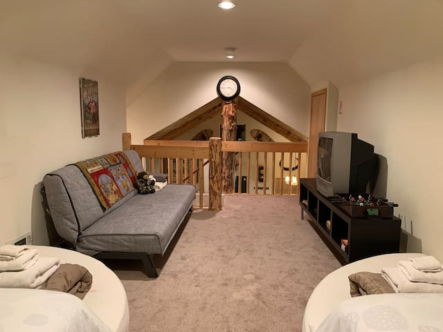 The sleeping loft sleeps and additional 3-4 and is the perfect hangout for the kids.