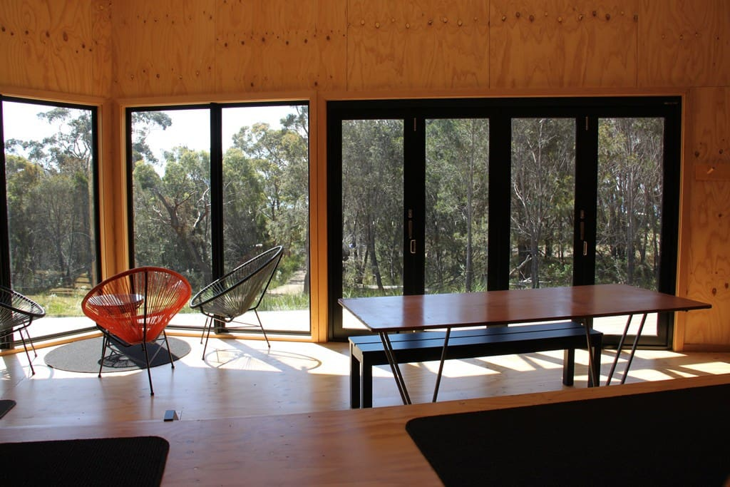 Split level hut with views of the bush and bi-fold doors to the deck