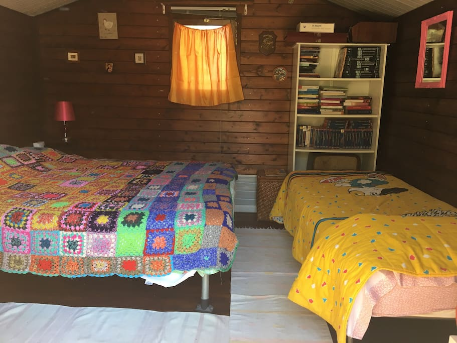 The cabin includes electric lights, a ceiling fan, one large bed for two, and a single bed.