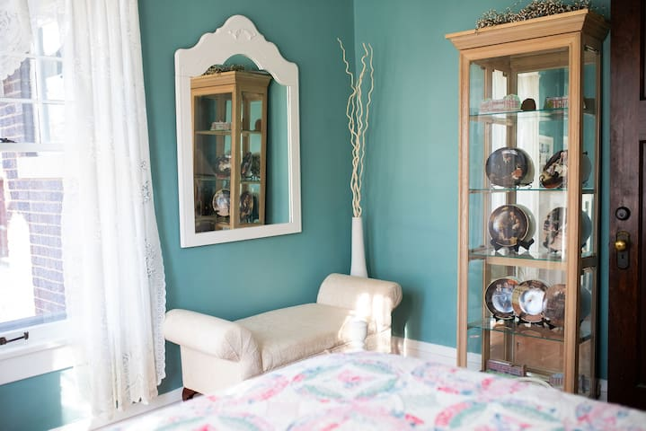 Teal Room with view of back lawn.