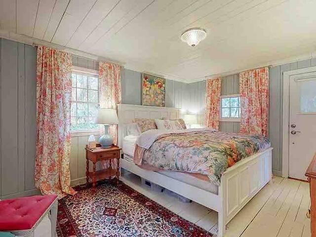 Master bedroom and door to its own outdoor deck and en-suite bathroom.