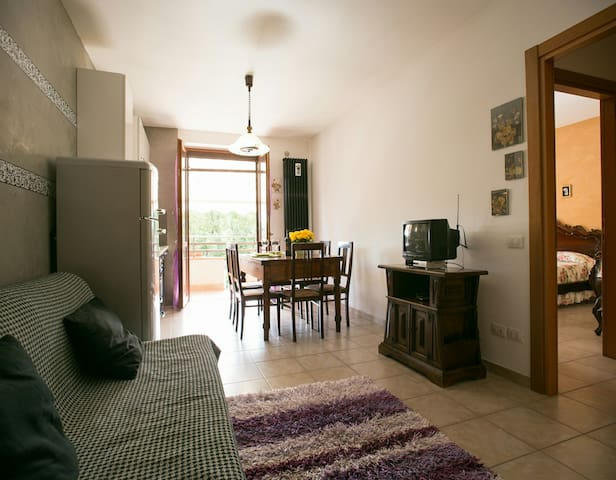 Flat with balcony, private parking