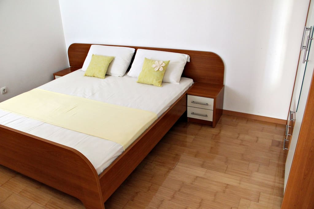 Bedroom with big comfortable double bed.