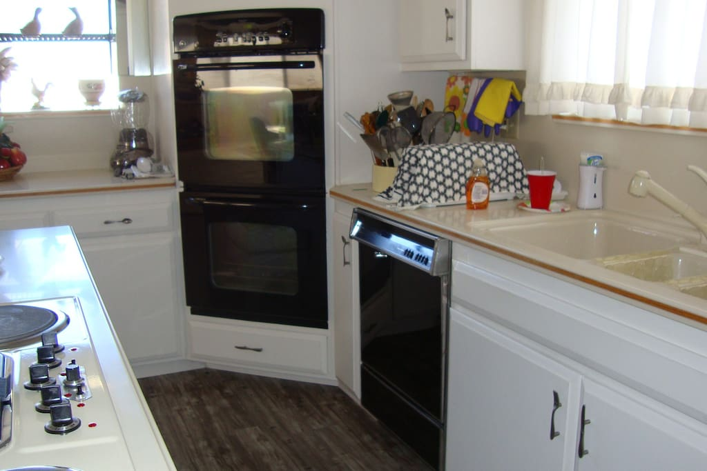 Portion of kitchen, microwave oven is located in island of kitchen