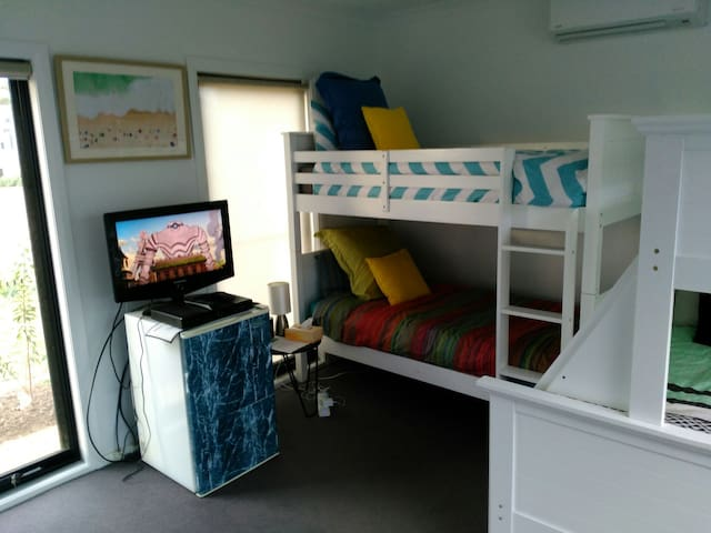 Fourth bedroom/rumpus, sleeps 5  and includes second TV (free to air only).