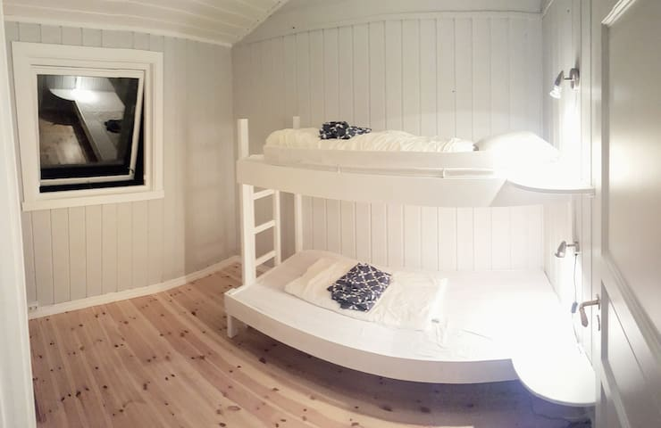 Guest house bedroom with two bunkbeds.