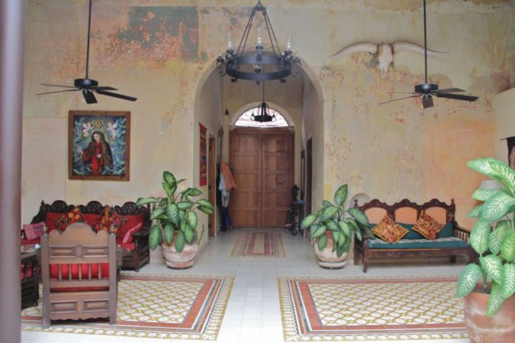 Main open space with 18' ceilings and solarium.   All furniture was made in Mexico and cement tile from Guadalajara.
